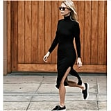 A Black Turtleneck Dress and Black Sneakers
