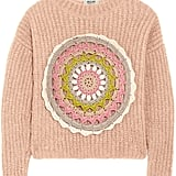 Moschino Cheap and Chic's crochet-embellished mohair-blend sweater ($795) is a stylish take on the sweaters grandma used to knit for you.