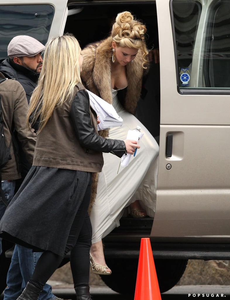 Jennifer Lawrence showed cleavage on her Boston set.