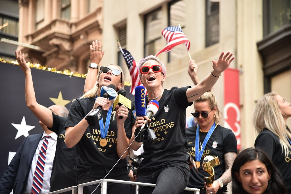 """Champagne and confetti are in store for the US Women's National Football Team. The 23 kickass players came home after their record-breaking World Cup win — here's a list of records the team broke if you need a refresher. They've been celebrating ever since, and June 10 marked a crowded and well-deserved ticker-tape parade in Lower Manhattan. On the US float, clad in sunglasses, medals, and """"World Champion"""" t-shirts, stood Megan Rapinoe, who won the coveted Golden Boot for most goals and Golden Ball for the best player in the tournament, along with teammates Alex Morgan (Silver Boot winner) and Rose Lavelle (Bronze Ball winner). Greats like Carli Lloyd and Julie Ertz joined them. If you missed the parade, there was lots of confetti (duh) and power poses from the team. Also, team members, including Crystal Dunn, started an """"equal pay"""" chant. We'd expect nothing less from the team whose platform at the World Cup brought attention to the US Football Federation gender pay gap. At one point, Alex sprayed the crowd with Champagne — which, if we could guess, felt like being showered with fearlessness. Ahead, check out pictures from the parade that will warm your heart and make you even more proud of these great women.      Related:                                                                                                           Calling the USWNT """"Arrogant"""" Is Infuriating to Any Girl Who Played Sports, and Here's Why"""