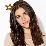 Who says that the Christmas tree is the only thing that gets to wear tinsel this year? Change all that with Urban Outfitters' festive headband ($8).