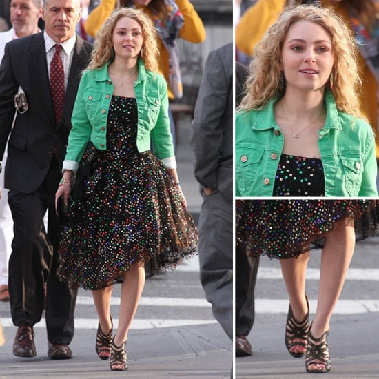 "Carrie styled a green denim jacket over her printed party dress with strappy black sandals, a few colorful bracelets, and her signature ""C"" necklace."