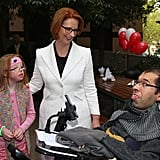 Julia Gillard met with Sophie Dean and Dr George Taleporos from the disabled community in Melbourne in May 2013 after holding a press conference announcincing that the Federal Government would increase the Medicare levy on income tax from 1.5 to two percent to help fund the National Disability Insurance Scheme.