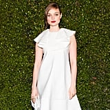 In a new spin on red, white, and blue, Bella Heathcote selected a ruby lip color and sky-blue nail polish to complement her pure white dress.