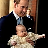 William was proudly outshone by his dapper baby boy at his christening.