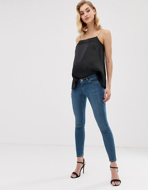 ASOS DESIGN Maternity lisbon mid rise skinny jeans in bright blue wash with over the bump waistband | ASOS