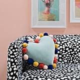 Velvet Pom Pom Pillow ($30)