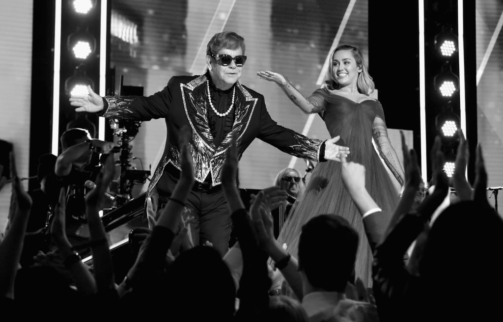 sir elton john and miley cyrus grammys 2018 black and