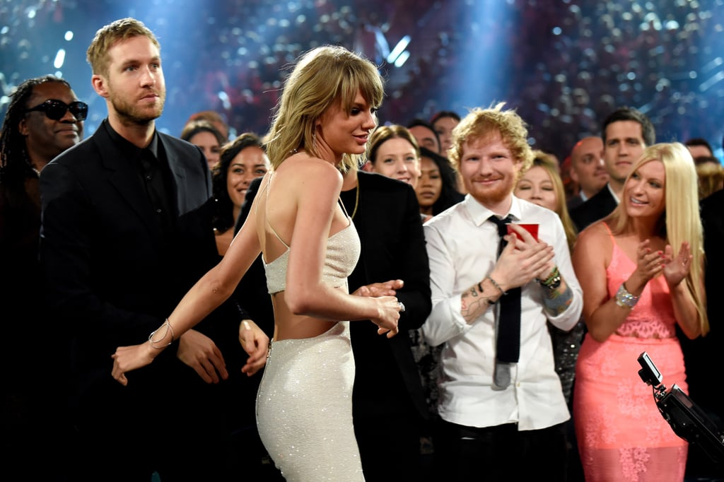 And Here's Ed Just Adorably Smiling at Taylor With His Cup