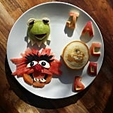 Kermit and Animal blueberry pancakes and fruit.