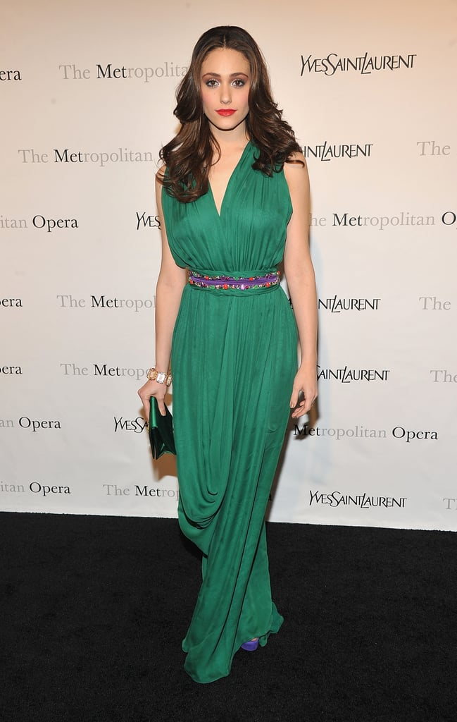 We love that Emmy Rossum opted for gorgeous, bold color — and a red lip to play perfectly off that emerald green hue.