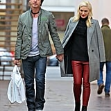 Gavin Rossdale held on tight to wife Gwen Stefani's hand.