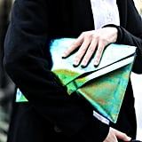 We love the shimmery finish on this oversize iridescent clutch.