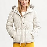 The down-filled body of this Banana Republic Puffer Jacket ($130) keeps you cozy; the drawstring waist ensures that you won't be swallowed up by the silhouette.
