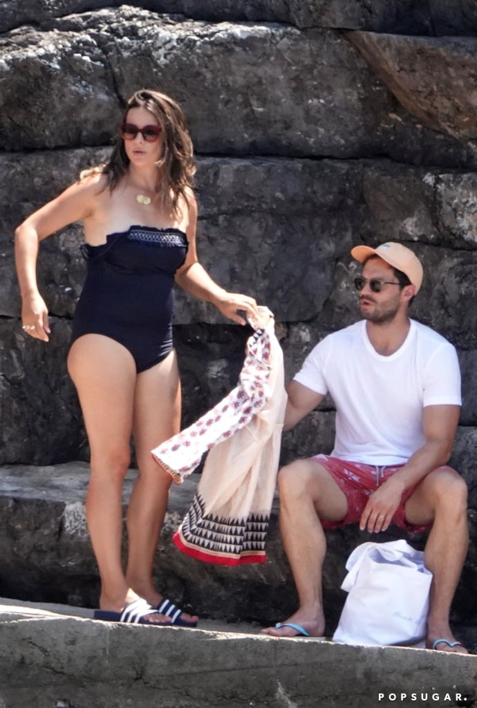 "It seems like almost every celebrity couple decided to spend their Summer in Europe this year, and Jamie Dornan and Amelia Warner are no exception. The couple are currently enjoying a relaxing holiday in Italy, and on Wednesday, they were seen out and about in Nerano. Jamie and Amelia appeared to be in good spirits as they grabbed a bite to eat at Lo Scoglio restaurant before going for a boat ride in the Italian sea. Sadly, Jamie didn't whip off his shirt this time around, but Amelia did slip into a cute off-the-shoulder one-piece.  Jamie and Amelia's getaway comes a week after the actor helped launch NI PanC, a support group for cancer survivors and relatives of cancer patients, at Mater Hospital in Belfast. Jamie lost his mother, Lorna Dornan, to pancreatic cancer at the age of 16, and he decided to join forces with the charity in her honour. ""I've always wanted to be associated to a charity that means something to me in a major way,"" Jamie explained. ""It all seemed very fitting, I could do whatever I can to promote awareness of this horrendous disease.""       Related:                                                                                                           9 Times Jamie Dornan and Wife Amelia Warner Couldn't Take Their Eyes Off Each Other"