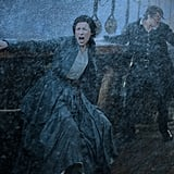 Jamie goes after Claire when she falls overboard during a storm