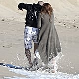 Jennifer Lopez and Casper Smart played in the surf on Valentine's Day.