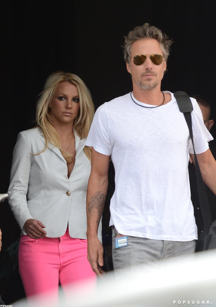 "Britney Spears and Jason Trawick left their Miami hotel and headed to work on The X Factor today. Britney brought a pop of color in bright pink Joe's jeans, which she paired with a low-cut white blazer. She and Jason have been in Florida all week while Britney takes care of her judging duties during X Factor boot camp with Simon Cowell, Demi Lovato, and LA Reid. Demi arrived in the sunny locale immediately after hosting Sunday's Teen Choice Awards, where she picked up two surfboards. Britney took the opportunity to congratulate her on Twitter, adding, ""Let's celebrate when you get to Miami."""