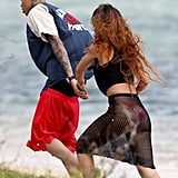 Rihanna and Chris Brown held hands on the beach.