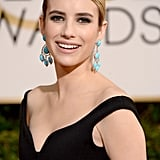 We'll be re-creating Emma Roberts's flawless beauty look for our next date night. Her smoldering eye shadow oozed sophistication, while her slick low ponytail added a splash of youthfulness.
