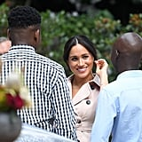 Meghan Markle Wearing an Evil Eye Bracelet and Beige Trench Dress