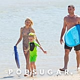 Naomi Watts and Liev Schreiber walked on the sand.