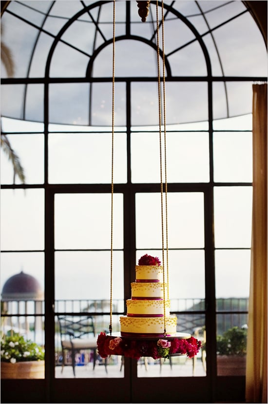 You may not have ever seen a hanging cake before, but this one's tiered shape and ribbon-like, beaded texture is familiar in the best way possible.  Photo by Chenin Boutwell via Wedding Chicks