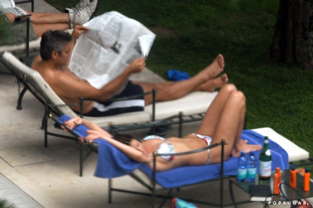 George Clooney read a newspaper in June 2004 while soaking up the Lake Como sun with former girlfriend Lisa Snowdon.