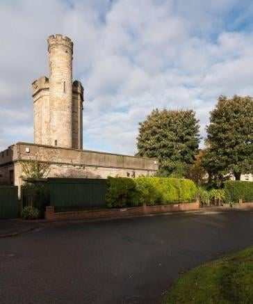 We may have given up our dreams of becoming a princess a long time ago, but thanks to a gorgeous new real estate listing, living in a castle can actually become a reality! The 19th-century Gothic villa may not look like anything special from the outside — well, except for that remarkable 50-foot tower — but inside, Balgray Tower appears to be right out of a fairy tale.  The three-bedroom castle is listed by Purple Bricks real estate company, and it boasts some of the most stunning features. Oh, did we mention it's listed for less than $300K? The castle is located in the heart of Springburn, Glasgow, in Scotland and is surrounded by private gardens and all the beautiful foliage one could imagine.  All that's missing from the castle is Rapunzel, although even she might've had a hard time getting down from the rooftop terrace. A spiral staircase leads upstairs and eventually to the top of the turret, where you have 360-degree views of Glasgow. Read on to see all the photos of the 1830 property for sale, and prepare to fall in love with all the chic Gothic vibes.