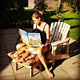 Doutzen Kroes spent some quality time with Phyllon by reading him a story out in the sun.