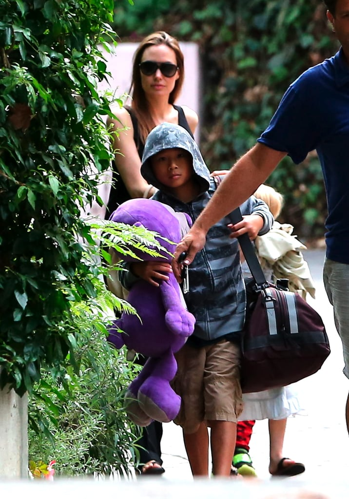 Pax carried his giant stuffed animal as he walked with Angelina Jolie.