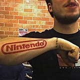 The name says it all with this one. Upping his geek cred even further is the Konami code encircling his wrist. Source: Flickr User knobbyknees
