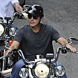 George Clooney rode his motorcycle with a pal to Milan.