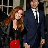 Isla Fisher and Sacha Baron Cohen arrived at the Les Misérables party on Wednesday night in LA.