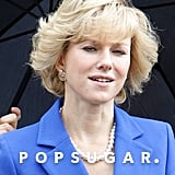 Naomi Watts wore a pearl necklace and blue suit on set.