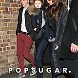 Victoria Beckham carried baby Harper in her arms while walking with Brooklyn Beckham in February.