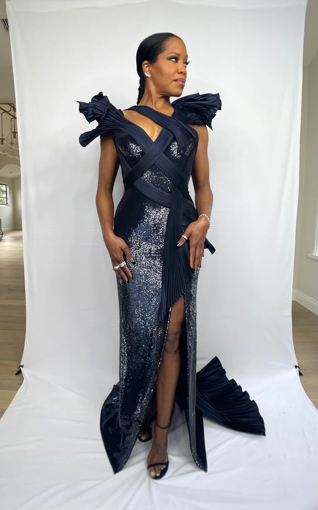 """Regina King is dominating award season. While her dog Cornbread did not make an appearance during the Critics' Choice Awards, her woven double ponytail did, and we are just as obsessed. On March 7, the One Night in Miami director pulled out all the stops for the virtual show, wearing a blue Versace dress, makeup from Pat McGrath Labs by makeup artist Latrice Johnson, and a ponytail that deserves to be looked at from every single angle. King shared a look at her double ponytail — created by celebrity hairstylist Larry Sims — on Instagram, and it's absolutely beautiful. """"When it's a week later and it still hits different. Thank you to @criticschoice for the #OneNightInMiami love!"""" she wrote.  Check out photos of King's flawless ponytail ahead.      Related:                                                                                                           Anya Taylor-Joy Did Her Own Makeup For the Critics' Choice Awards Like the Queen She Is"""