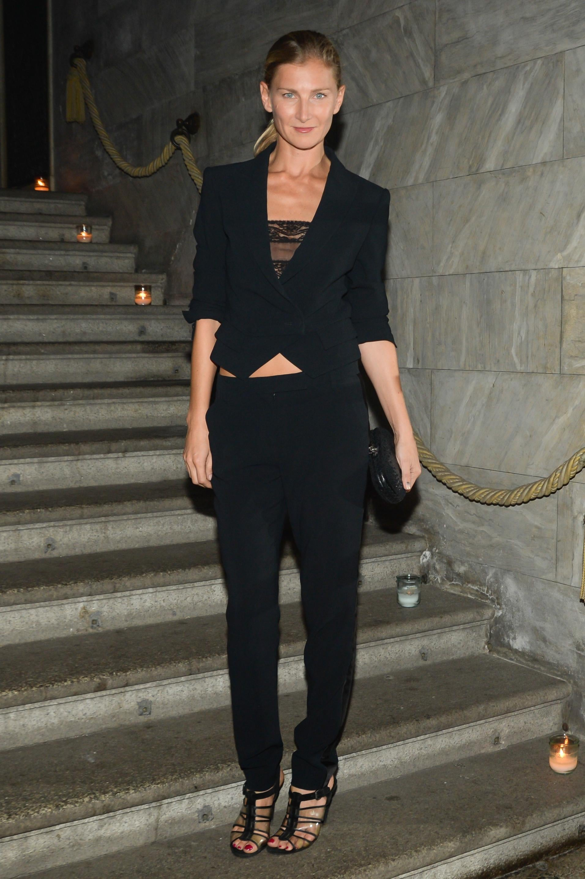 In Milan, Elizabeth Von Guttman complemented her strappy sandals with an all-black look at the Brian Atwood dinner.