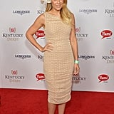 Lauren went all out for the Kentucky Derby in 2013, staying true to the dress code in a tan sheath dress from her Paper Crown collection. She paired the look with nude heels from her LC For Kohl's line, as well as a Derby-appropriate oversize hat. Lesson from Lauren: embrace the occasion while staying true to your signature style.