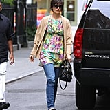 In August 2008, Katie layered up in a floral tunic and camel cardigan while running around NYC.