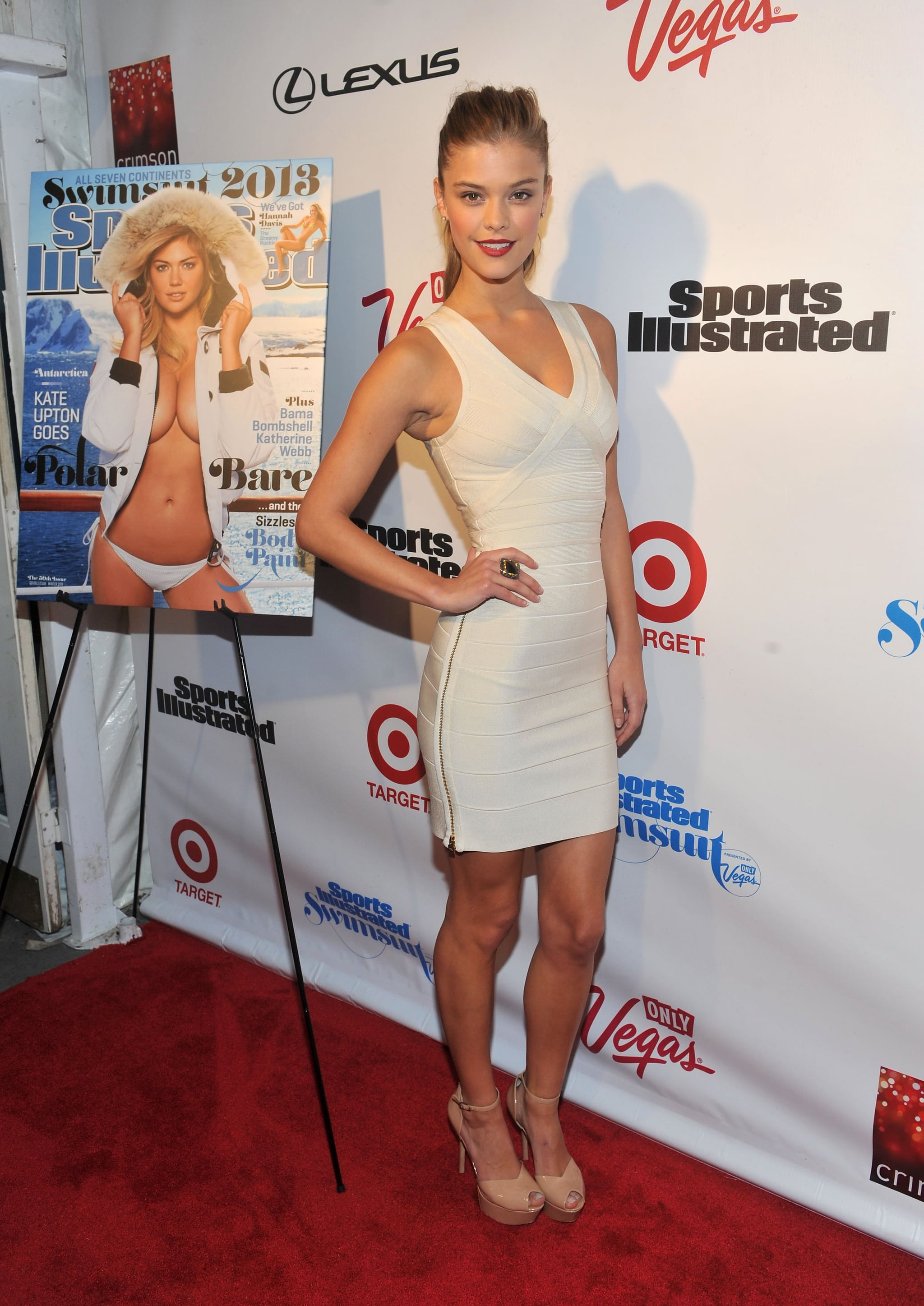 Nina Agdal wore a white dress and nude heels.