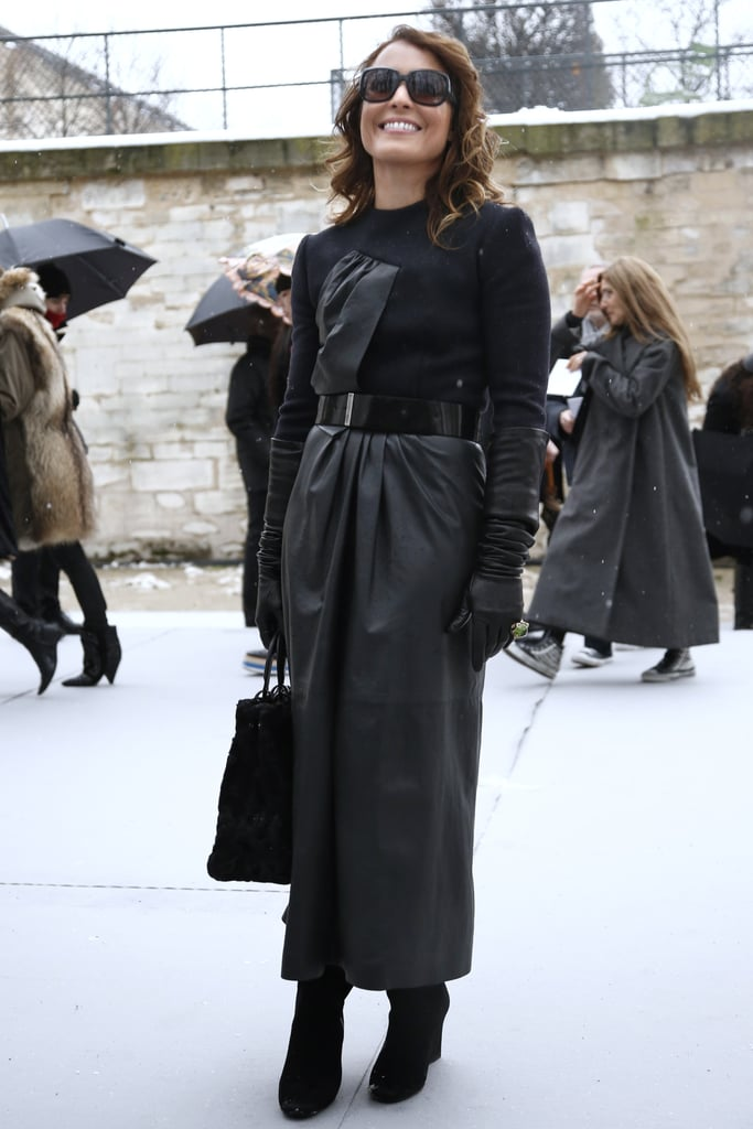 Noomi Rapace was nothing short of Old Hollywood glamorous in this mixed-media floor-length black coat and oversize sunglasses.