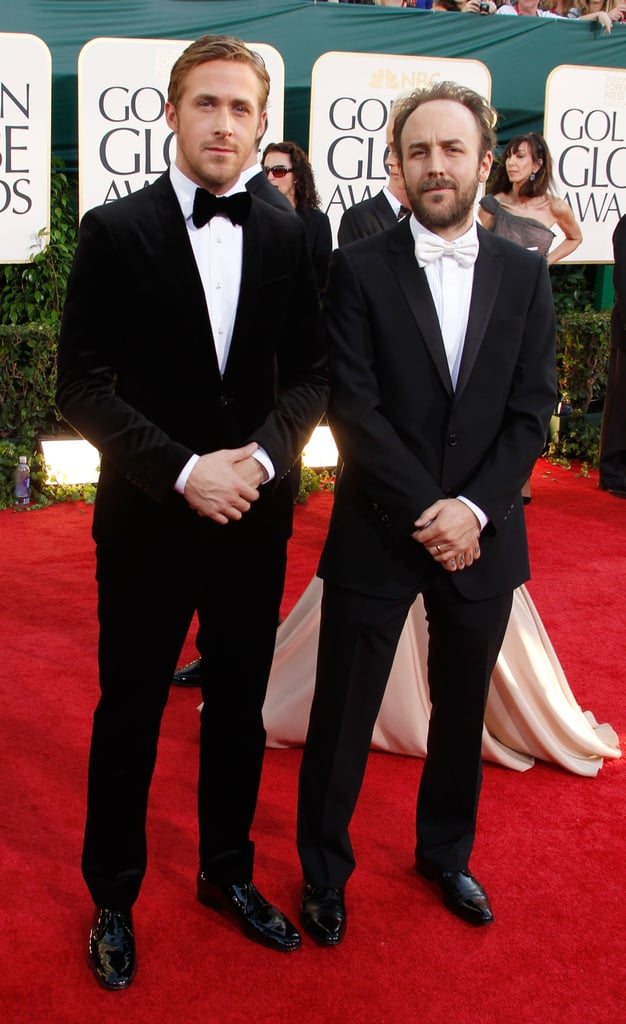 Ryan Gosling — in a Ferragamo blazer and shoes — smiled for the cameras at tonight's Golden Globes with his Blue Valentine director Derek Cianfrance. Mr. Gosling is in the running for tonight's best actor in a drama award, while his costar, Michelle Williams, is up in the same category for actresses. Ryan and Michelle have been making the award season rounds over the last few weeks to support their critically acclaimed film — what did you make of her Valentino dress pick?