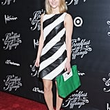 AnnaSophia Robb was on-trend in this black and white striped Alice + Olivia leather dress ($997), as well as a green bag and pink ankle-strap Jean-Michel Cazabat pumps, at the Breakfast at Tiffany's Broadway opening night in NYC.