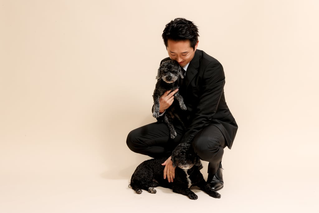 "If there was an award for finest appearance at the 2021 Critics' Choice Awards, Steven Yeun would certainly take home the prestigious honor. Ahead of the award show on Sunday night, the Minari star and best actor nominee posed for a handful of dashing photos, and we just can't stop thinking about it. In addition to looking super fine in a Prada suit and working the camera from all angles, he even shared a sweet moment with some precious little dogs. I mean, come on! It doesn't get any cuter than that. Let's just say, Steven has certainly won our hearts this award season. See more pictures from his gorgeous photo shoot ahead.      Related:                                                                                                           The Critics' Choice Awards Confirmed No Dress Is ""Too Much"" For a Virtual Red Carpet"