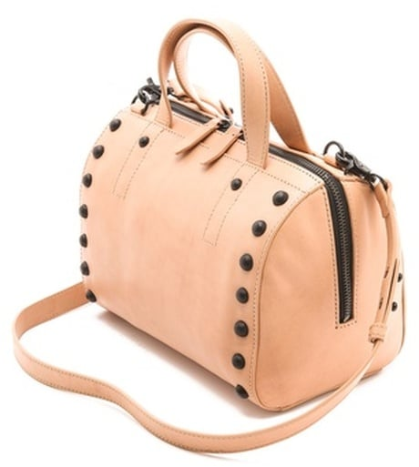 I always love Loeffler Randall's take on what's in style, and this new Small Duffel Bag ($395) gives me that top handle look for Fall with the crossbody strap I love. Plus, the studs make the bag so much more than a simple work bag without being overly fussy. Cute bag that's big enough for me to wear to work every day? Now that's a must have. — Melissa Liebling-Goldberg, fashion and beauty director