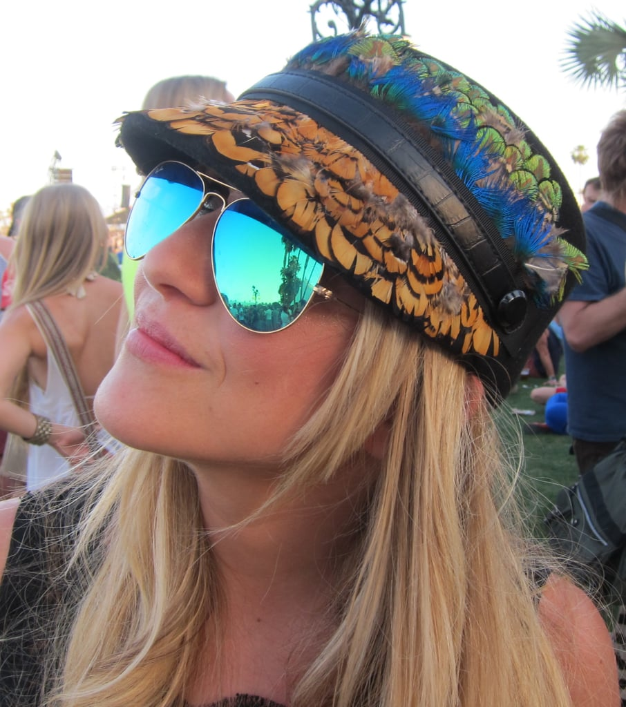 This feather-trimmed hat had a carefree, artistic vibe when paired with mirrored aviator shades.