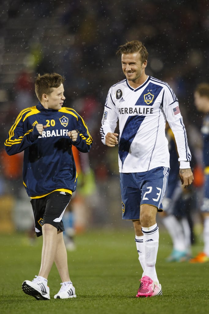 David Beckham welcomed his son Brooklyn Beckham onto the soccer field.