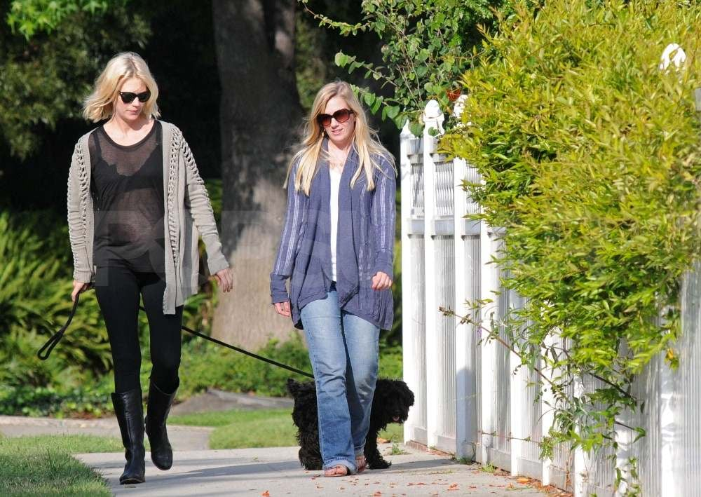 January Jones Shows Off Her Baby Bump in a Sheer Shirt