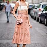 With a High-Waisted Skirt
